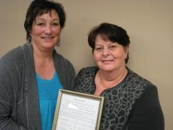 PEIUPSE President Debbie Bovyer presents Cathy MacKinnon her award in the Why Unions Matter contest.