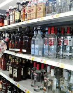 store shelf with liquor bottles on it