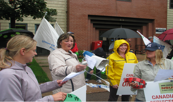 PEIUPSE President Debbie Bovyer with members on picket line of striking CBS workers